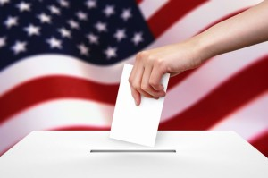 13621133 - hand with ballot and box on flag of usa