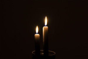 55773869 - two candles in the dark